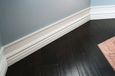I loved the big baseboards in the old house I lived in during college. Now, a way to get the same look without replacing the existing baseboards: add small molding a few inches above and paint wall space in between the same color. Home And Deco, Diy Home Improvement, Home Interior, Interior Design, Kitchen Interior, Home Hacks, Vignettes, My Dream Home, Home Projects