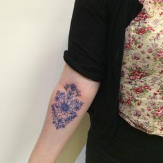 Beautiful blue ink floral piece by Juju