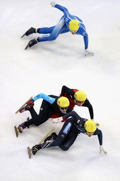 (Below-Top) Ryosuke Sakazume of Japan, John-Henry Krueger of United States, Wu Dajing of China and Vladislav Bykanov of Israel compete in the Men's 500m Pre-Preliminaries during Samsung ISU World Cup Short Track at the Oriental Sports Center on 26 Sep 2013 in Shanghai, China.