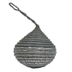 These vibrant and eye catching ball ornaments are woven together by hand with sisal fiber. Brighten up your holiday decor with a sweet little global token that holds a special meaning in Rwandan cultu