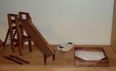 Miniature slide and a miniature real sandbox.