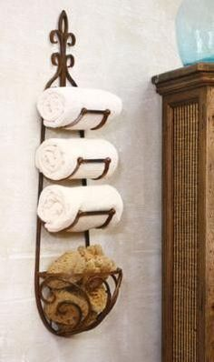 "Repurpose!! ""Wine Rack"" for a towel holder - I have had something similar to this in my bathroom for 10 years. I have no cabinets for towels, so it is perfect!"