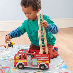 Le Toy Van-Imagination and a sense of adventure are key with the Wooden Fire Engine Playset by Le Toy Van. Beautiful wooden construction gives way to a sturdy vehicle with extendable ladder and accessories, complete with poseable Budkin Fire Chief. Fire Engine Toy, Toy Playhouse, Kids Role Play, Traditional Toys, Green Toys, Wooden Train, Fire Trucks, Home Depot, Autos