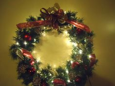 I made this wreath last year using a thin round steel rim and the branches from an old artificial Christmas tree. Mesh Garland, Garlands, Christmas Tree Branches, Steel Rims, Christmas Decorations, Holiday Decor, Spirit, Wreaths, Seasons