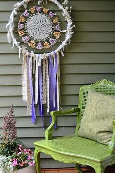 This dream catcher was made from an old bicycle rim, a vintage doily, ribbons and strips of fabric. A brightly painted chair makes for a welcoming spot to sit and daydream.