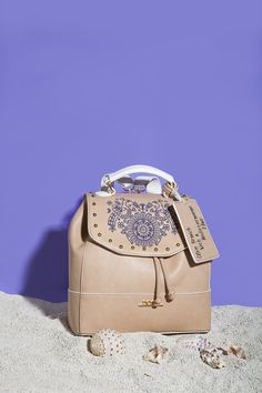 """GREEK SPIRIT Inspired by the sea`s deep blue and Greek island`s white, our new 'Greek Spirit' collection will virtually tour you to the Aegean and Ionian islands. The slogan of the line is """"My Greek Island Home"""" and """"Olive Branch with a Mediterranean Flair"""". Stunning handmade engraved details and prints on bags and wallets embellish our new collection.  www.doca.gr #greekspirit #greek #island #blue #fashion #patterns Island Blue, Fashion Patterns, Greek Islands, Blue Fashion, Deep Blue, Slogan, Fashion Backpack, Wallets, Spirit"""
