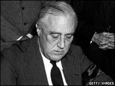 President Roosevelt signs declaration of war against Japan - 8 December 1941