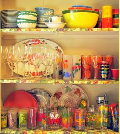 Vintage glassware---another collection DONE right! Love the little elephant stack, second shelf to the right. ;)