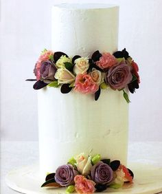 Summertime Fresh. A sheik five tier cake iced with white chocolate ganache and finished with seasonal fresh flowers from Sweet Art