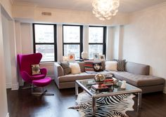A tour of one of Chicago's chicest condos from the fashionista who lives there! This place is amazing and FULL of inspiration top to bottom! [via www.thechicagolifeblog.com] home // decor // jonathan adler // black and white // mod // retro // interiors // whimsical // lucite // zebra