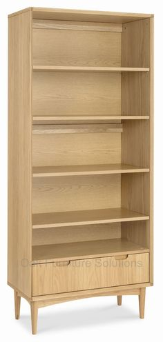 Buy an Oslo Oak Wide Bookcase. Neutral tones and stylish design make this bookcase a versatile accompaniment to any contemporary home. Adjustable shelves and a large fitted drawer add practicality to this retro infused bookcase. Slim Bookcase, Bookcases For Sale, Black Bookcase, Large Bookcase, Shelves, Bentley Design, Wren Kitchen, Natural Interior, Shelving