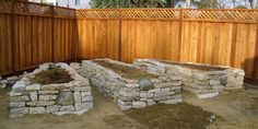 Raised beds made out of reused cement chunks.  (Hoping to do this using the chunks we create while removing half of the driveway!)