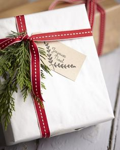 Holiday Gift Wrapping Ideas: white wrapping paper with red ribbon. (Source: Hadley Court blog, Lynda Quintero-Davids)