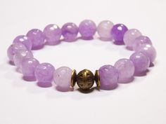 Beautiful Light Amethyst gemstones with a brass focal bead. • This is the perfect everyday bracelet. • Wear this alone or layer with other bracelets for that bohemian look.... #bracelet