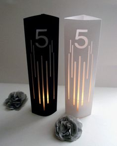 Lines Wedding Table Number Luminaries / Table Markers / Modern Table Numbers / Art Deco Table Numbers by MasonRabbitsPaperie on Etsy https://www.etsy.com/listing/268957132/lines-wedding-table-number-luminaries