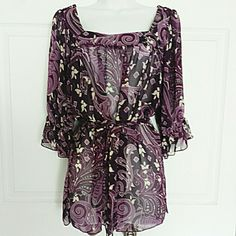Sheer Print Blouse Pre-owned belted square neck sheer blouse by Design Works with dark purple, lavender, and cream floral print. Blouse has gathered elastic bell like sleeves. Great work or casual attire. Looks great with or without the belt as pictured. Blouse has no signs of wear. Mint condition. Size S. NOTE: Blouse runs tad bit large. Fits more like a medium. Design Works Tops Blouses
