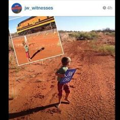 """Awwwwww...I love this as it so well represents the zeal of everyone during the 2014 campaign last August. > """"Out in the middle of the outback in Australia last August @hemiandme's (James Bounsall) son was waiting for trains to pass by and then held up his JW.ORG sign to show everyone."""" <3"""