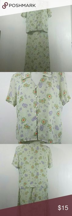 Joan leslie skirt set Two piece skirt and top. Its green with a beautiful purple and green floral design. The shirt has buttons up the front and is short sleeved. In good condition. The size is 12 pettite joan leslie  Skirts Skirt Sets
