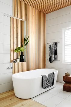 """We used the Tasmanian-oak battens to define the bath area and bring warmth to the room,"" says Sarah."