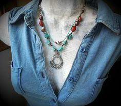 I designed this classic Southwest necklace around a lovely pewter squash-blossom-style pendant, combining it with variegated nuggets of genuine turquoise and rich Poppy Jasper. all bound together with waxed linen cording and Greek leather cord in cocoa brown. Ive dotted the strands here and there with more gleaming pewter, and added my own handmade findings and wire wrap in fine and sterling silver. The shortest strand of this necklace is 21 and 1/2 full length (using the full length of ...