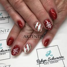 Glitter red and Christmas designs, oval gel nails