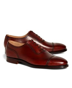 64fa0402719 Expertly crafted for Brooks Brothers in fine calfskin. Leather lining and  soles. Genuine Goodyear