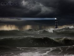 During a dark raging ocean storm a light house shines it's powerful beam of light to any nearby boats or ships warning them of the danger.