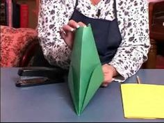 Tutorial for making paper robin hood style hats with yellow paper feathers but can be easily modified to make Peter pan hats with the paper feather being red instead.