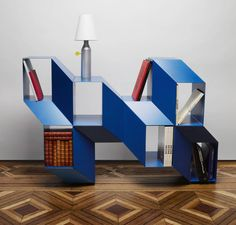 Lebanese designer Charles Kalpakian, specialized in product design, is the creator of Rocky : a bookshelf that plays on 3D effects and a perspective's illusion. This steel shelf, available in black and blue, is flat and doesn't feature any relief. That's only thanks to the angles, the shadows and the cubic forms that this furniture can be seen in relief, according to different perspectives.