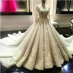Item Type: Wedding DressesBack Design: ZipperTrain: Cathedral/ Royal TrainBuilt-in Bra: YesDecoration: Beading,Lace,Crystal,AppliquesSilhouette: Ball GownSleeve