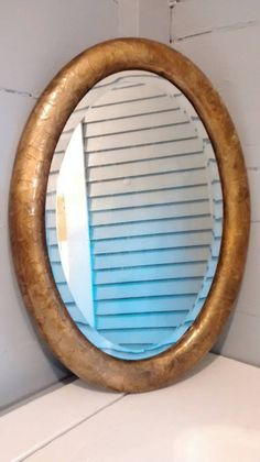 Check out this item in my Etsy shop https://www.etsy.com/listing/235692869/antique-mirror-oval-ornate-gold-wall
