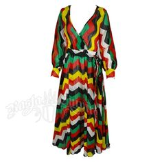 Sheer, full length dress features bold, chevron stripes done in Rasta colors.   Wrapped V-neck bodice has an elastic waist, waist ties, and long cuffed sleeves.   This maxi, surplice dress has a full flared skirt with an attached white half slip underneath. 100% Polyester.