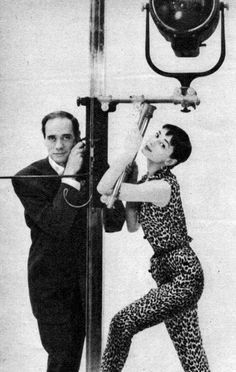 May 28, 1954, Audrey Hepburn photographed with her fiancé Mel Ferrer (actor and director) by Richard Avedon at his studio in New York (USA), for a fashion editorial for Seventeen Magazine (edition of July 1954). Audrey was wearing: Jumpsuit: Simplicity Patterns (sleeveless, of cotton corduroy with a print of leopard skin, fabric by Juilliard).