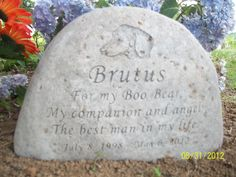 The beautiful headstone my daughter, Enola, had made for Brutus' grave.