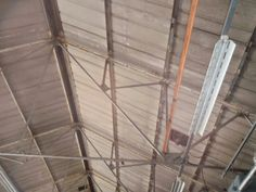 Corrugated Asbestos Cement roofing sheets to a warehouse roof