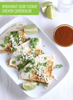 Easy Weeknight Slow Cooker Chicken Quesadillas - put a whole @tynerpondfarm chicken in a slow cooker during the day, whip up an easy dinner at night! Chicken and enchilada sauce can be made in advance so all you have to do is assemble the meal right before you eat.
