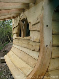 This is a 9 step picture guide to building a tiny oak playhouse with a green roof.