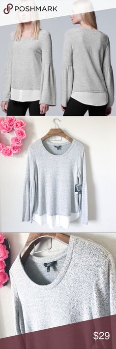 Simple Vera by Vera Wang Bell Sleeve Sweater Top Brand new with tags! (000-0000)   PRODUCT DETAILS: •Size: Large •Colors: Gray, White  •Made in Vietnam •Measurements: coming soon!  •77% Rayon, 18% Polyester, 5% Spandex (Crazy Soft! •Hand Wash •Undershirt Skirting to give the illusion of layering •Long Bell Sleeves  •Classic Scoop Neck •Marbled Fabric  •Effortlessly chic  Tags: heather hether dark wonder layers blouse twofer work career business professional party event dinner school Simply…