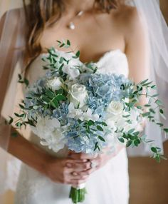 Something (Not Boring) And Blue For Your Wedding Day - blue and white bouquet with greenery