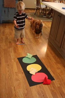 This is a super-easy activity that teaches colors too! Here's what you'll need: 3 pieces of construction paper (red, yellow, and green), a piec