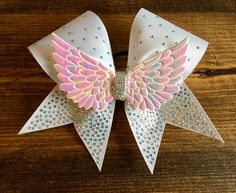 Cheer bow. Rhinestone angel wing. Adorable! #Cheer #cheerleader #cheerbow #cheerleading #hairbow #angelwings