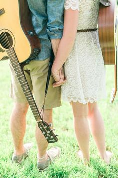 Cute engagement session with couple holding hands with guitars on their backs
