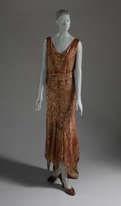 Woman's Dress  Jean Patou (France, 1880-1936; House founded 1914)  House of Jean Patou (France, founded 1919)  France, 1929  Costumes; principal attire (entire body)  Silk plain weave (crepe) with metallic thread supplementary warp patterning, printed  Center back length
