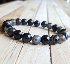Check out this item in my Etsy shop https://www.etsy.com/listing/506088777/10mm-black-eye-agate-bracelet-men-yoga