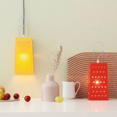A fabulously fun table or wall light for the kitchen; grater becomes lamp!  Be.bop collection is classic and minimal at the same time. The selection of colors of these products has a strong urban connotation given by the neutral shades of the lamp, which contrast with the lively colors of the electrical wires. Mix and match and choose from a selection of 5 coloured lamps and 9 coloured cables.