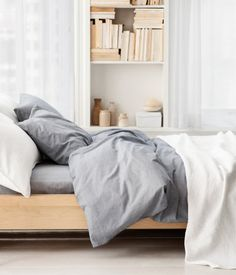 serene = grey linen and blonde wood! Take a look at www.naturalbedcompany.co.uk for soft grey linen bedding and solid wood beds in ash, maple and many other hardwoods!