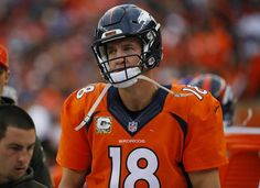 A dejected Denver Broncos quarterback Peyton Manning looks on from the sidelines during an NFL football game between the Denver Broncos and the Kansas City Chiefs, Sunday, Nov. 15, 2015, in Denver. (AP Photo/Jack Dempsey)