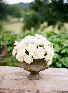 White Rose Centerpiece in Stone Vase | photography by http://katiestoops.com/