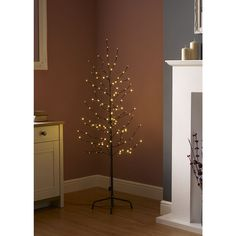 Wilko Pre-Lit Twig Tree 5ft/152cm Let there be light! Our 5ft/150cm LED twig tree is a modern and stylish way to display a Christmas tree with a difference this festive season. It's mains operated for indoor use, with a discreet brown cable and, although the bulbs are non-replaceable, they are highly energy efficient and have a lifespan far greater than that of ordinary bulbs.   Contains non-replaceable LED bulbs. For indoor use only. Assembly required. H96cm W14cm D7.5cm Warm white