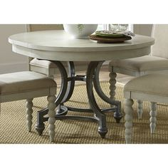 Pretty round dining table, we love you. HomeDecorators.com #aldridge ...